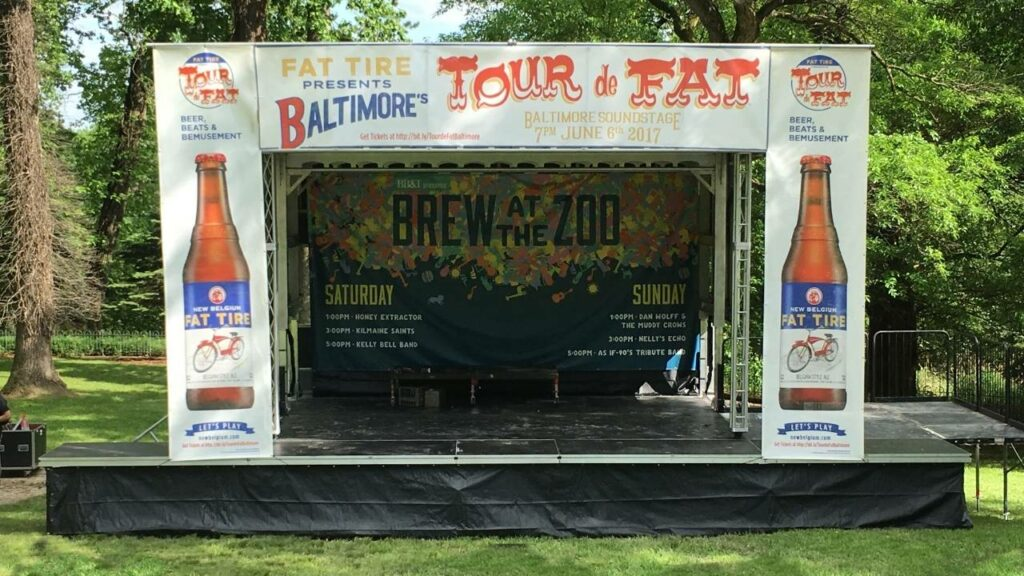 Mobile stage rental with full banner package for a beer and wine festival at the Maryland Zoo in Baltimore.
