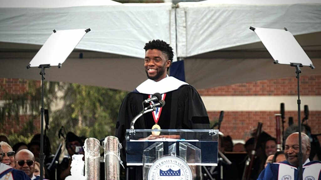 Chadwick Bosman speaking from the podium at Howard University Commencement ceremony is 2019